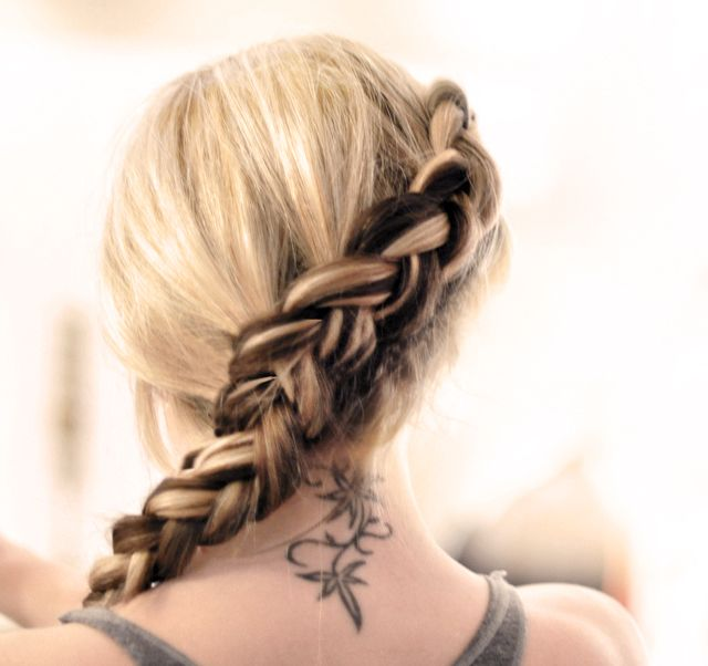 hunger games braid-  The braid is basically [her] Side French Braid low up-do hair tutorial but left out instead of pinned up and braided UNDER instead of OVER as seen above and called the Inside out French braid. It's done exactly the same way as a regular French braid but instead of braiding over the other sections, you braid them under, creating this bulbous braid that sort of sits atop your head rather than against it.