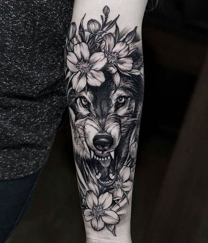 beautiful tattoos wolf head and white flowers tattoo in black and gray  beautiful tattoos wolf head and white flowers tattoo in black and gray
