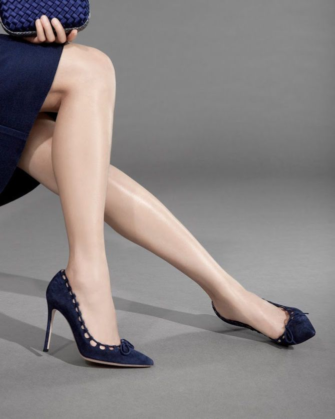Gianvito Rossi's pointed-toe pumps are crafted of Denim (navy) suede. The bow-front pumps feature a suede tie that threads through