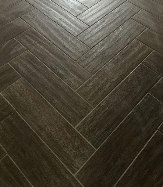 Dark Wood Tile Installed In Herringbone Pattern Tile With Style
