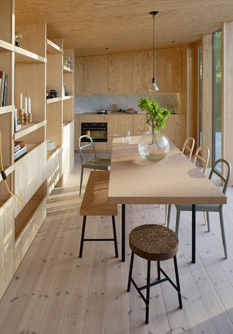 The raw quality of the timber interiors of this house has been off-set by more luxurious materials, including a Carrara marble worktop and splash-back in the kitchen, and polished brass taps and door handles.