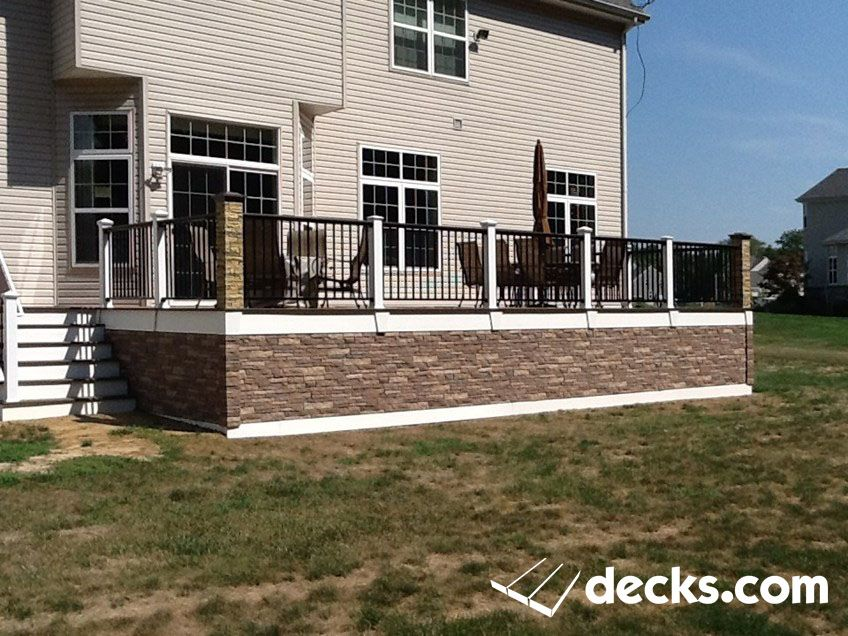 This Deck Has Trex Decking With A Faux Stone Skirt By