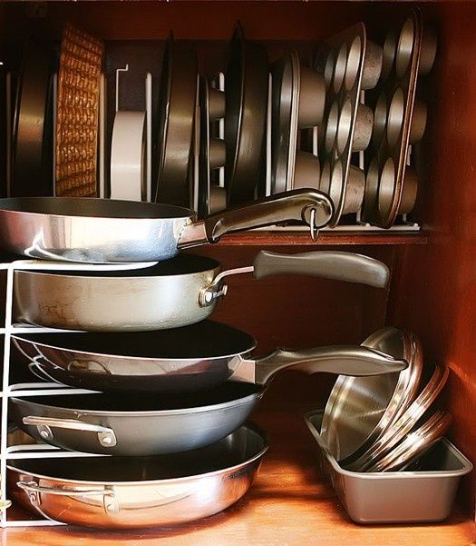 Love two things about this picture! 1. The way the pans are stacked. It's easy to just pull one out without having to pull all of them out. 2. How the smaller pans are all sideways. Again, easier to get to!