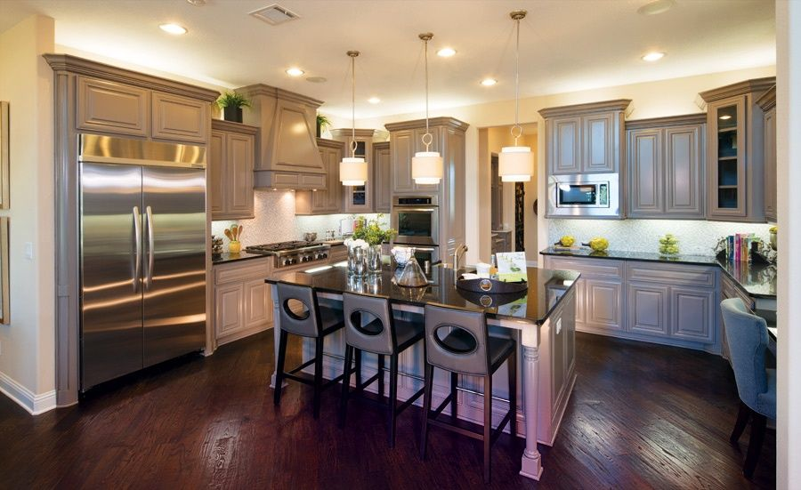 Country Kitchen with Pendant Light, Raised panel, Inset cabinets, Corian Solid Surface Countertop in Deep Nocturne, U-shaped