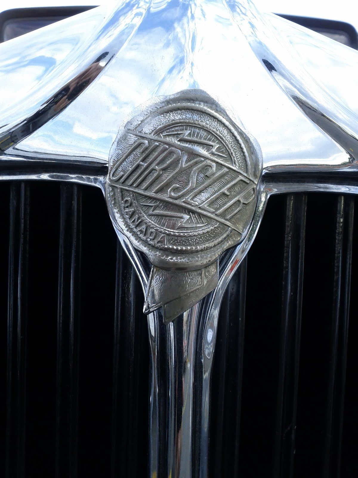 Grill brand mark from a Canadian-built 1930's Chrysler.
