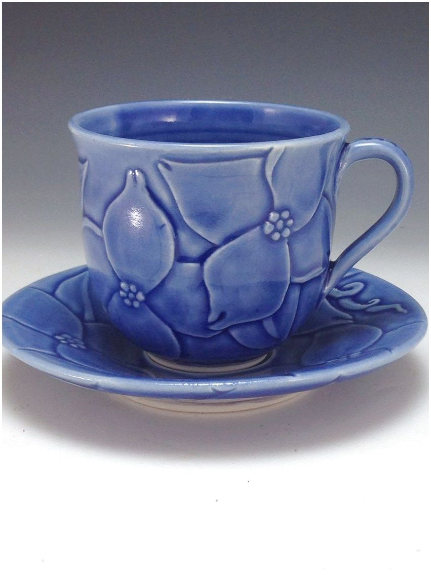 Tea cup and saucer stylized dogwood design bas relief carving anne