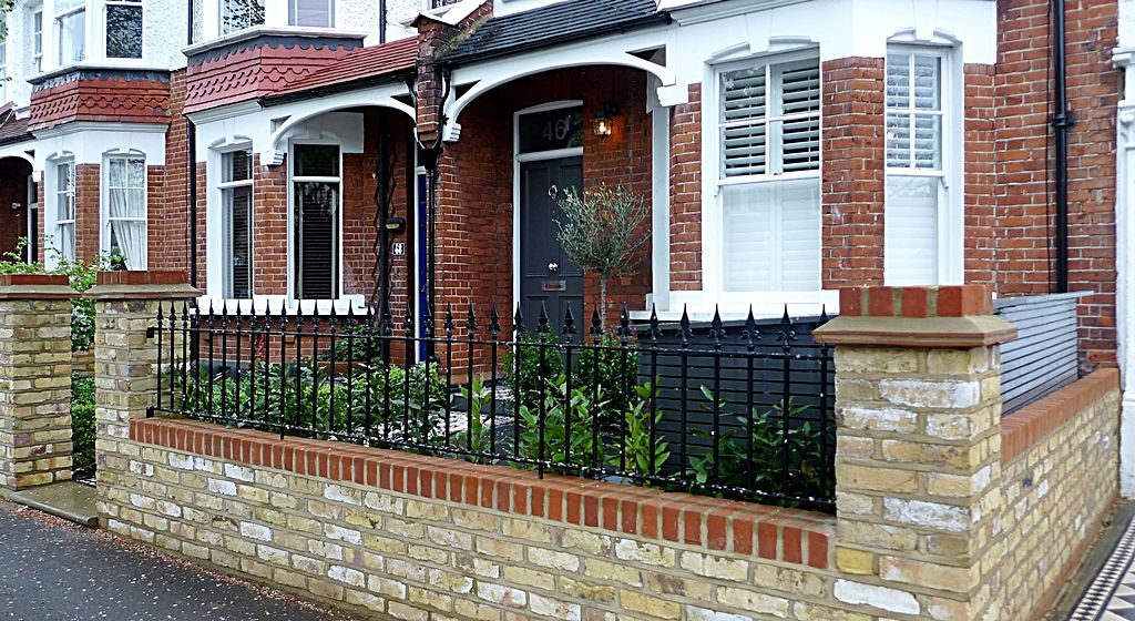 Wall Railings Designs outdoor stone steps and iron railing hgtv Victorian Front Garden Design London Mosaic Tile Path Red Brick Garden Wall And Natural Stone Capsjpg