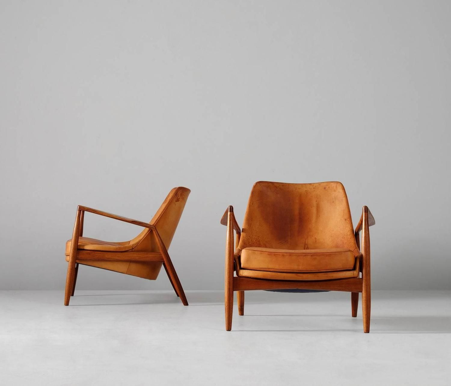Ib KofodLarsen Pair of 'Seal' Lounge Chairs in Cognac Leather, Sweden, 1956 is part of Arm chairs living room - For Sale on 1stdibs  Stunning pair of 'Seal' lounge chairs in original cognac leather, designed by Ib Kofod Larsen  Produced by OPE Sweden, 1956  This extremely rare model