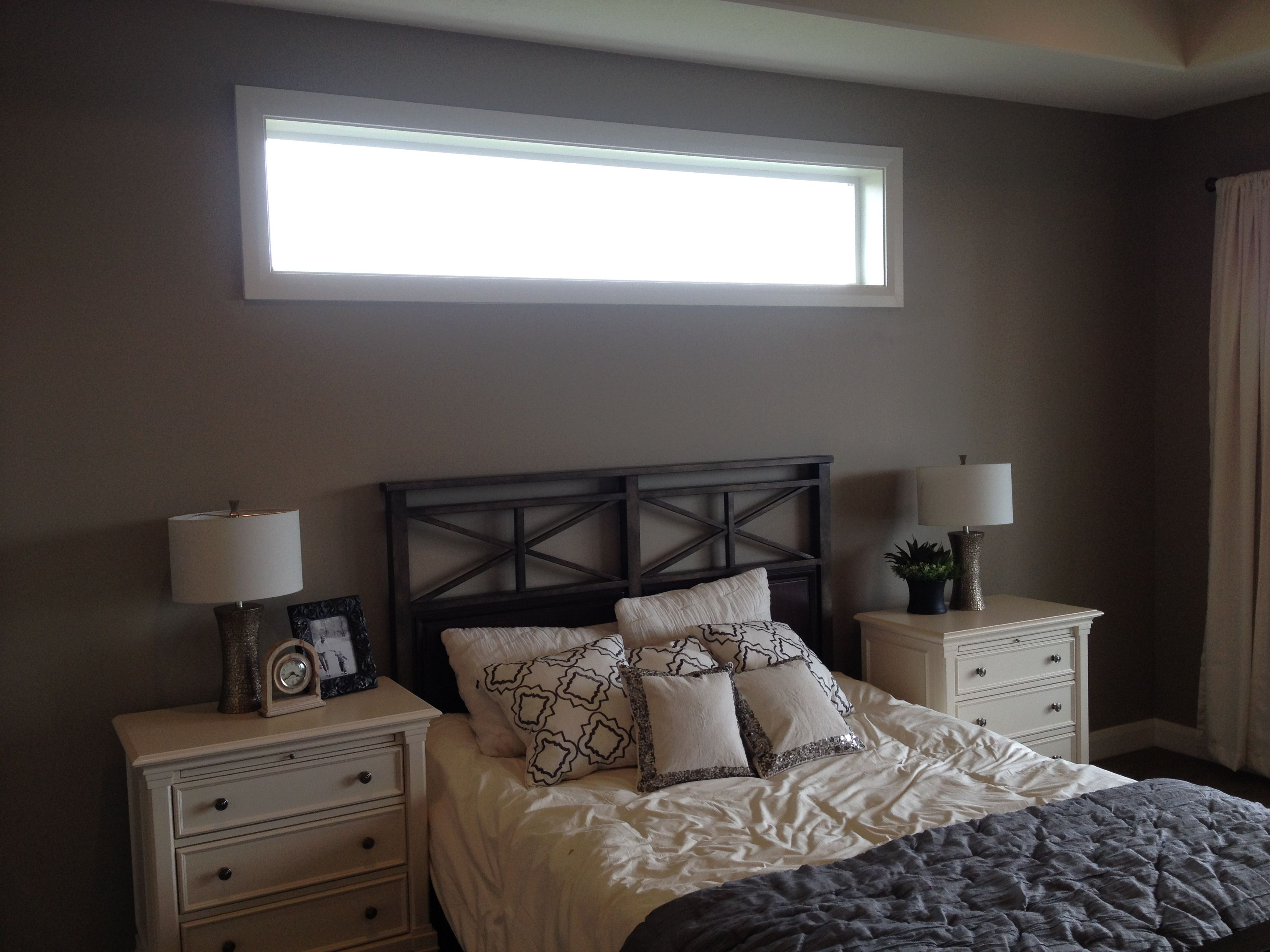 Bed under window ideas  love the long thin window above the bed  bedroom windows