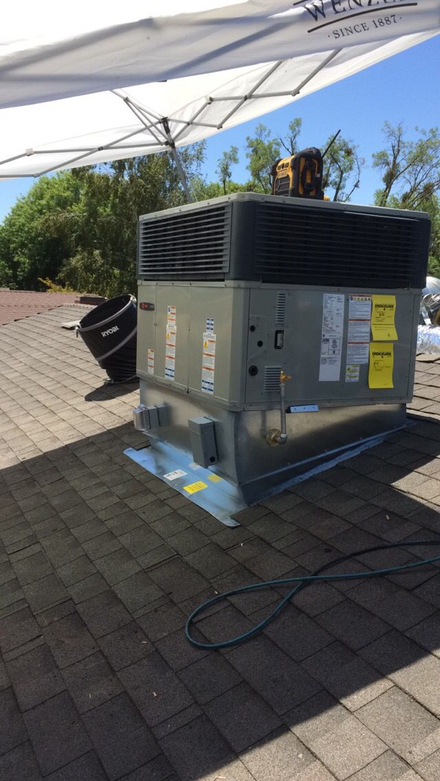 New a/c unit and roof tie in with 30 year composition