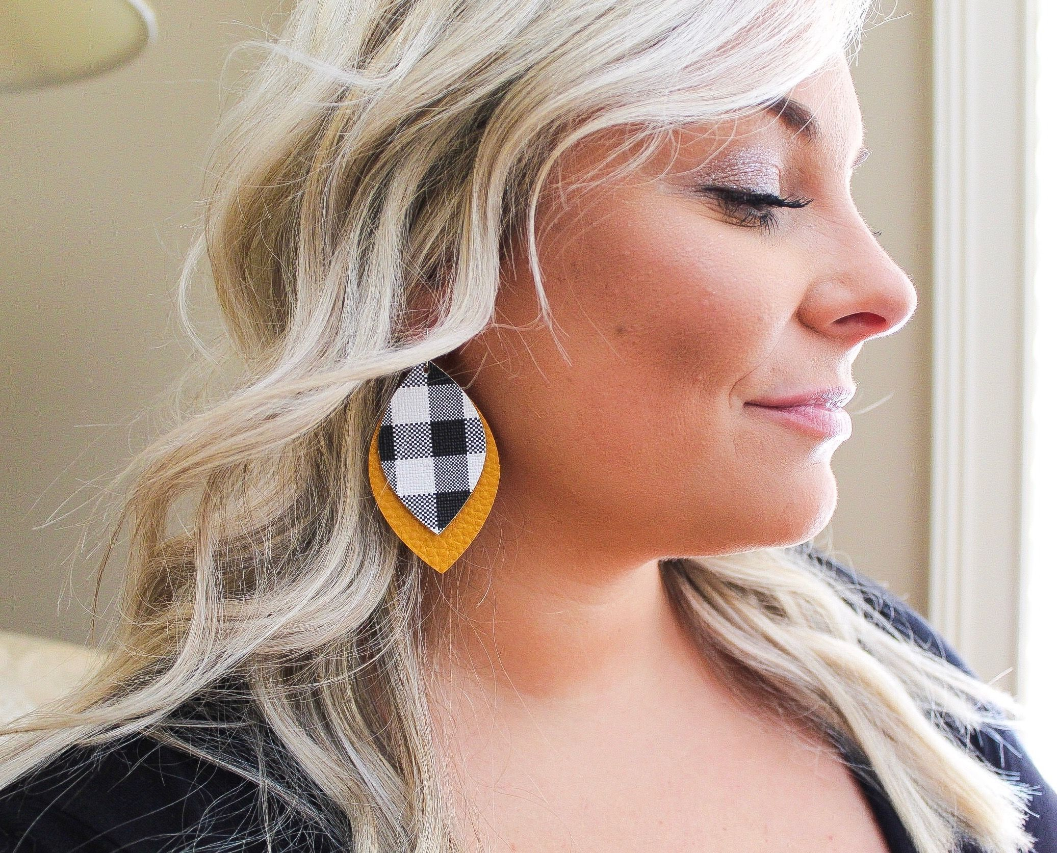 Buffalo Plaid over Mustard Oval Leaf  Fall Accessories are in full swing We are loving these Black and White Buffalo Plaid and Mustard