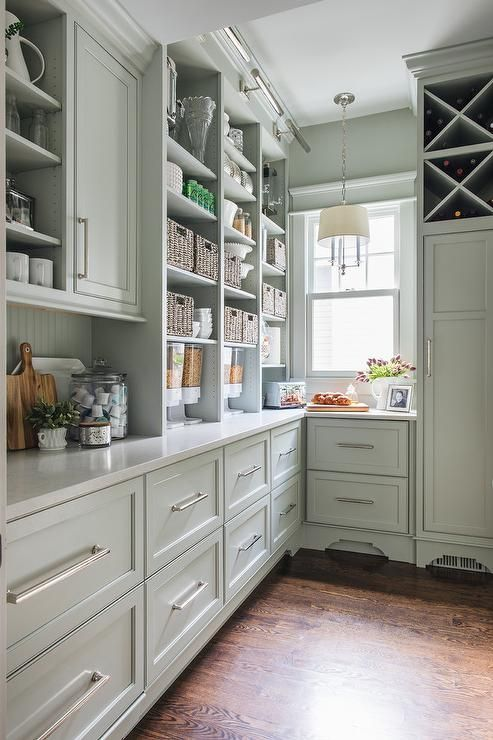 Best This Well Appointed Green Gray Pantry Boasts A Rustic Wood 640 x 480