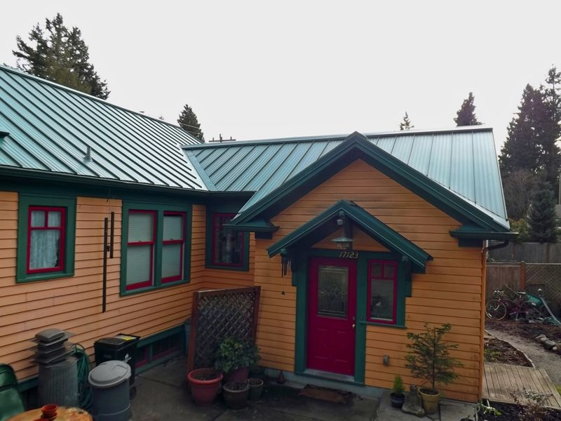Green roof paint combo sorta of mimics the color of a - Exterior paint colors with green metal roof ...