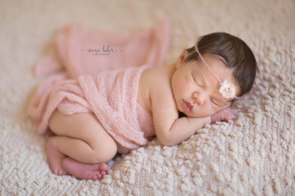 Newborn baby girl blanket headband posing beanbag backdrop photography studio