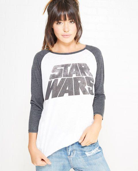 "<p>Star Wars™ fans rejoice! Now you can show off your fandom in super cute style! Details include a soft knit body, contrast raglan sleeves, a shirttail hem, and ""Star Wars™"" screen printed across the front.</p>  <p>Model wears a size small.</p>  <ul> <li>Crew Neckline</li> <li>3/4-Sleeves</li> <li>Unlined</li> <li>Cotton / Polyester</li> <li>Machine Wash</li> <li>Imported</li> </ul>"