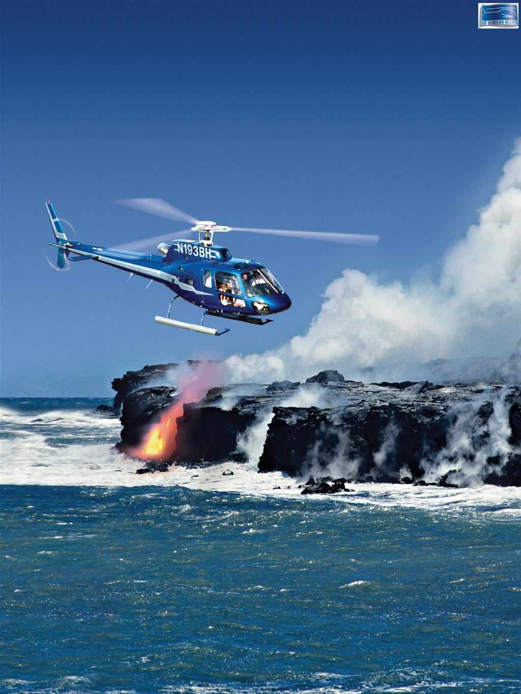Blue Hawaiian Helicopter Flying Over Molten Lava Flowing Into The
