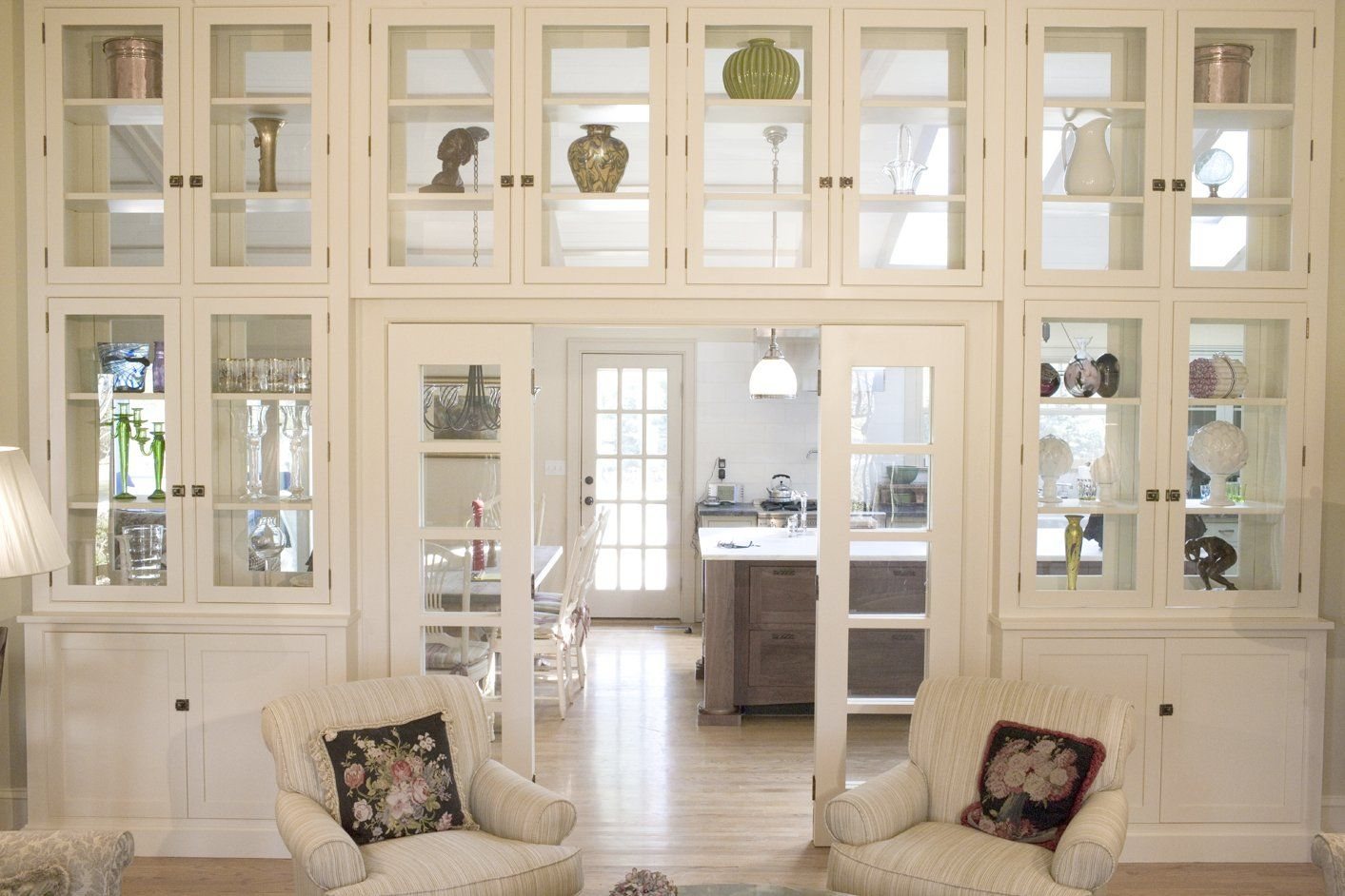 Gorgeous Double Sided Glass Cabinetry Serve As A Room Divider In This Home Love How It Opens Up The Spa Room Divider Hanging Room Dividers Metal Room Divider