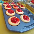 Cheesecake Cupcakes :)  My faves!  Instead of cherry filling, I use strawberry!