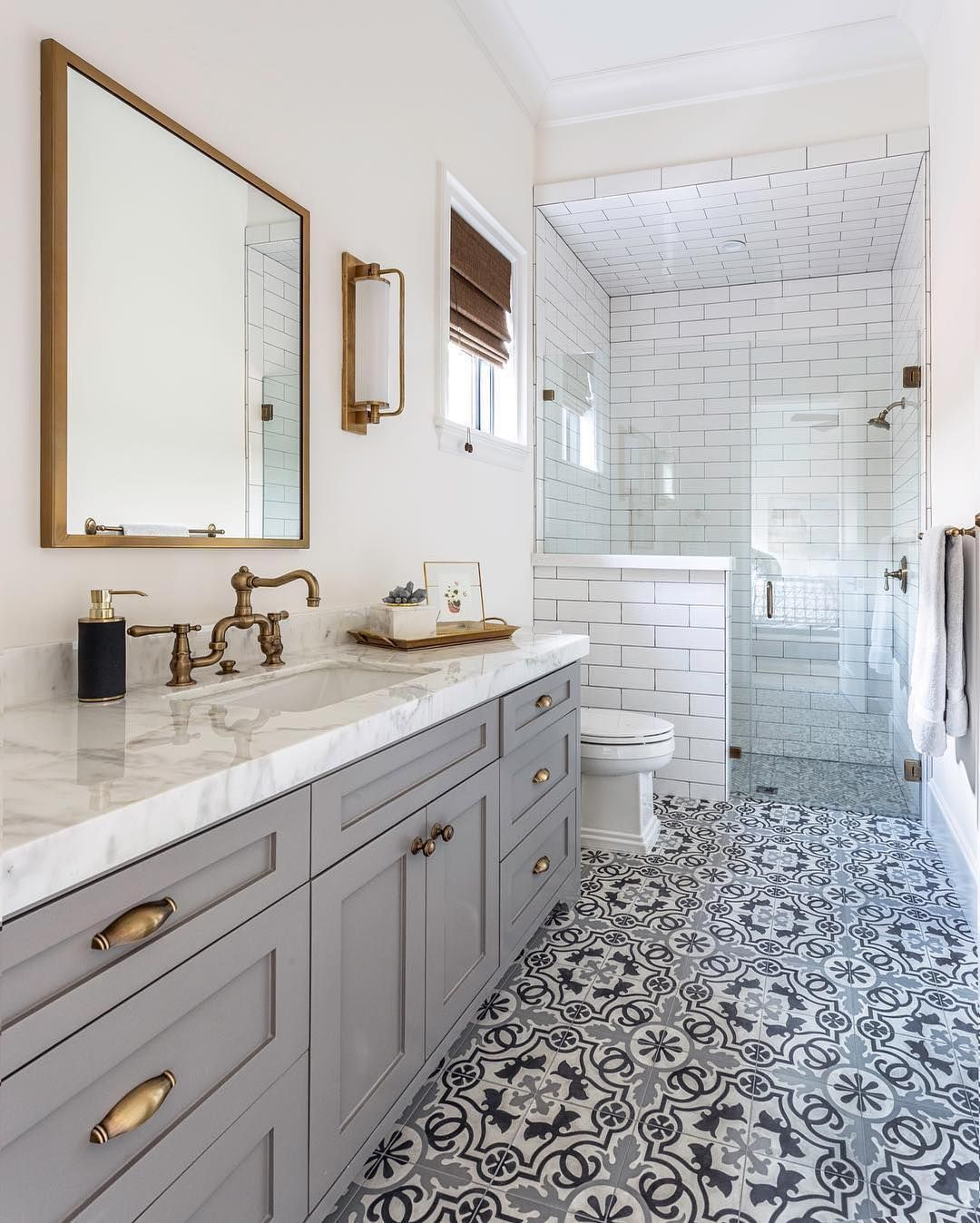 The Patterned Floor In This Bathroom Perfectly Compliments The Marble Countertop And White Subway Tiles Th Bathroom Trends Small Bathroom Bathroom Inspiration