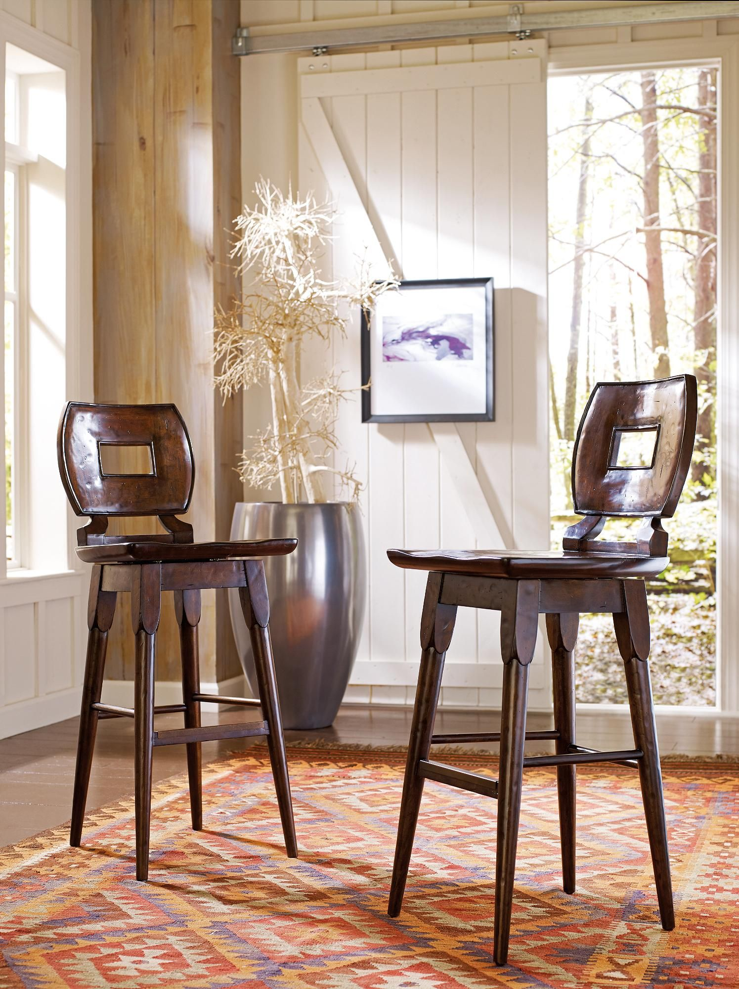 Appealing. Comfortable. Convenient. Everything that is expected from a seat in a high-end bar is brought home with this classic wood bar stool.