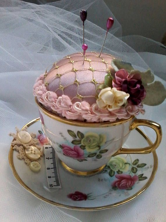 I have repurposed this lovely vintage tea cup and saucer into a unique shabby chic pinHat pin cushion Featuring french vintage trim buttons and satin flowers this piece w...