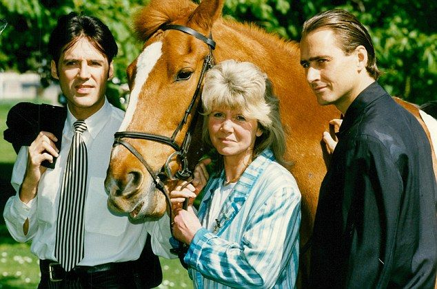 Jilly Cooper, centre, on the set of Riders, a feature length film for ITV in 1993, with Mi...
