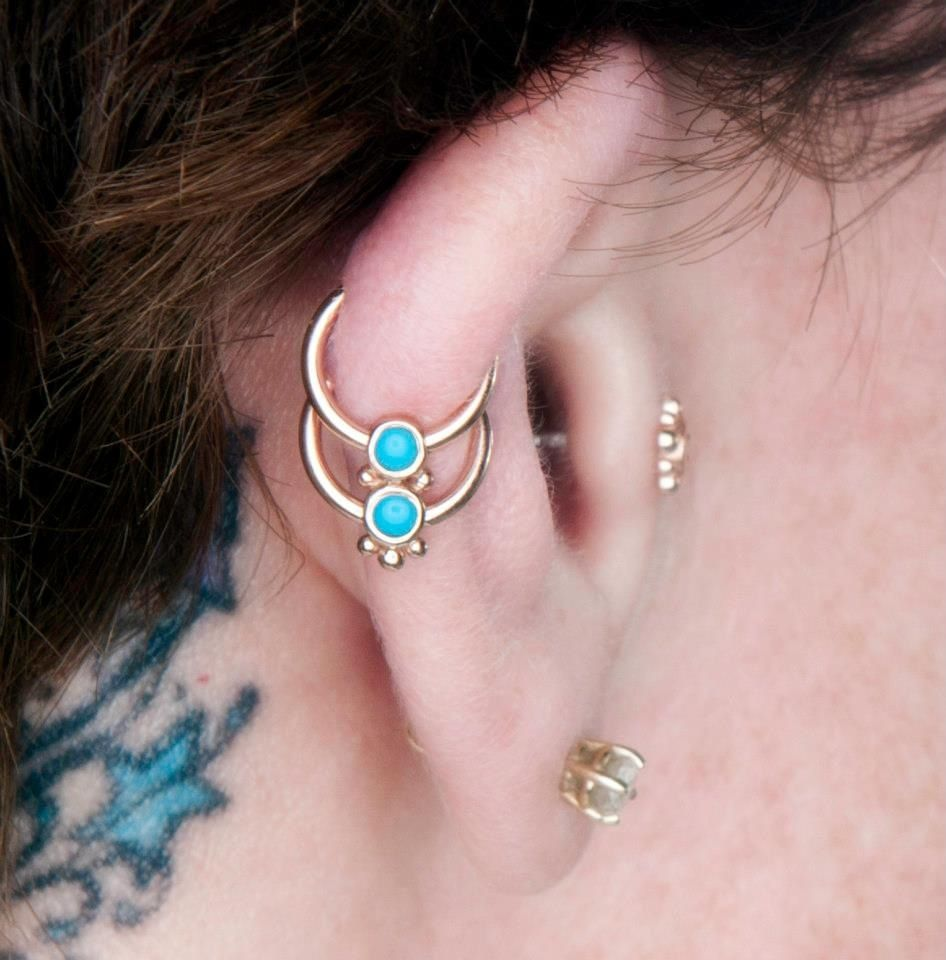 Double nose piercing plus septum  Double ear cartilage piercings with one of a kind rose gold jewelry