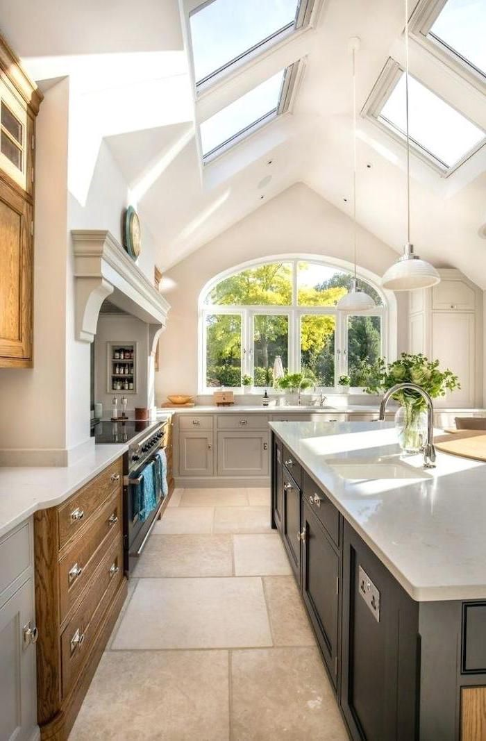 black kitchen island grey wooden cupboards skylights tiled floor what is a vaulted ceiling in on kitchen cabinets vaulted ceiling id=99615