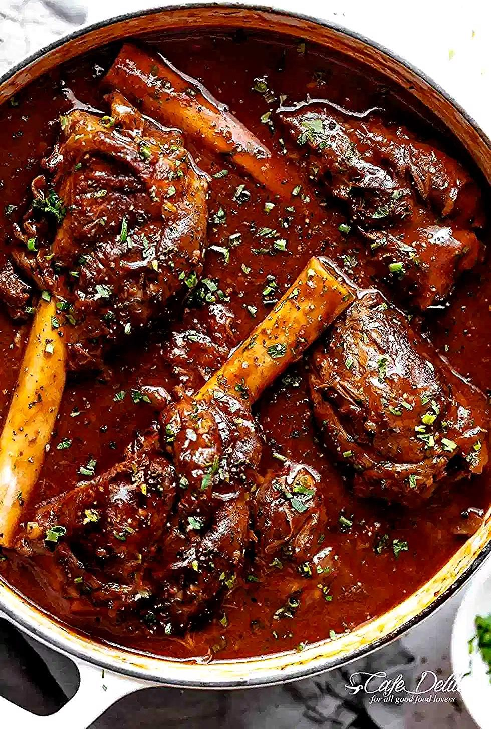 Braised Lamb Shanks In A Casserole Pot In 2020 Lamb Stew Recipes Slow Cooked Lamb Shanks Slow Cooked Lamb