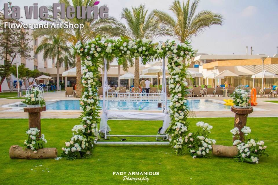 Wedding decoration swing flowers bride and groom seater open wedding decoration swing flowers bride and groom seater open air wedding novotel junglespirit Image collections
