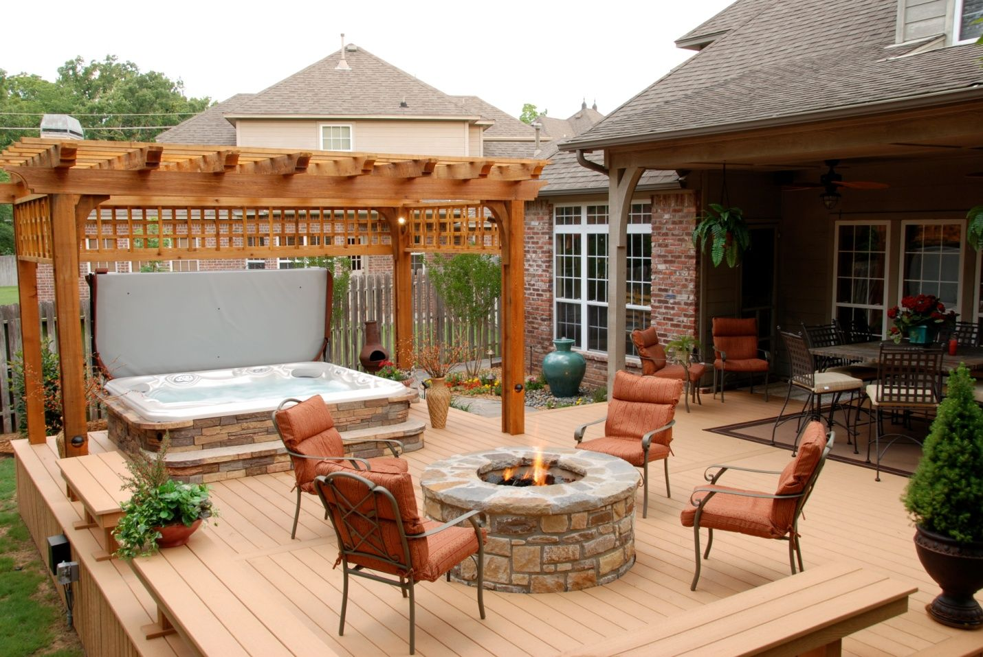 hot tub and stone firepit on deck  like the pergola