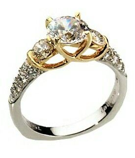 I love this for a woman's wedding band its beautiful but its between this one and another ring but I love the two toned but I wish it just had only a single stone at the center
