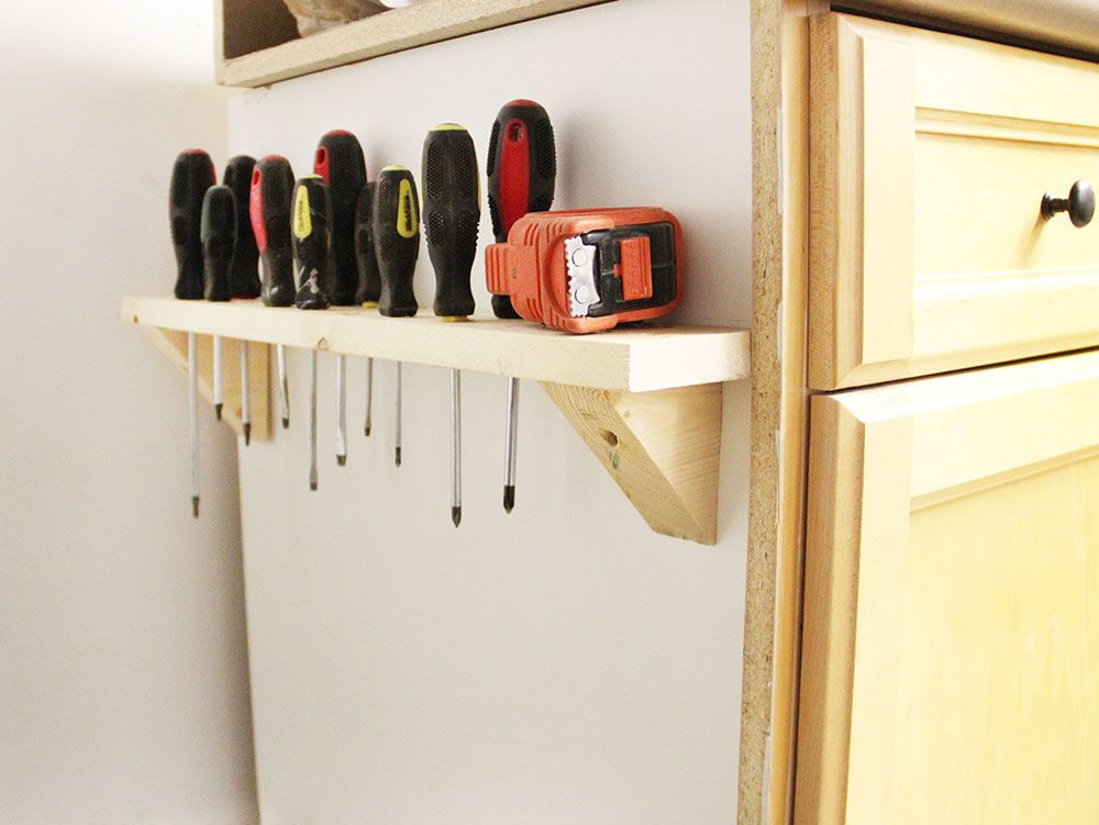 DIY Screwdriver Storage with boards, mitre saw and screwdriver. Easy.