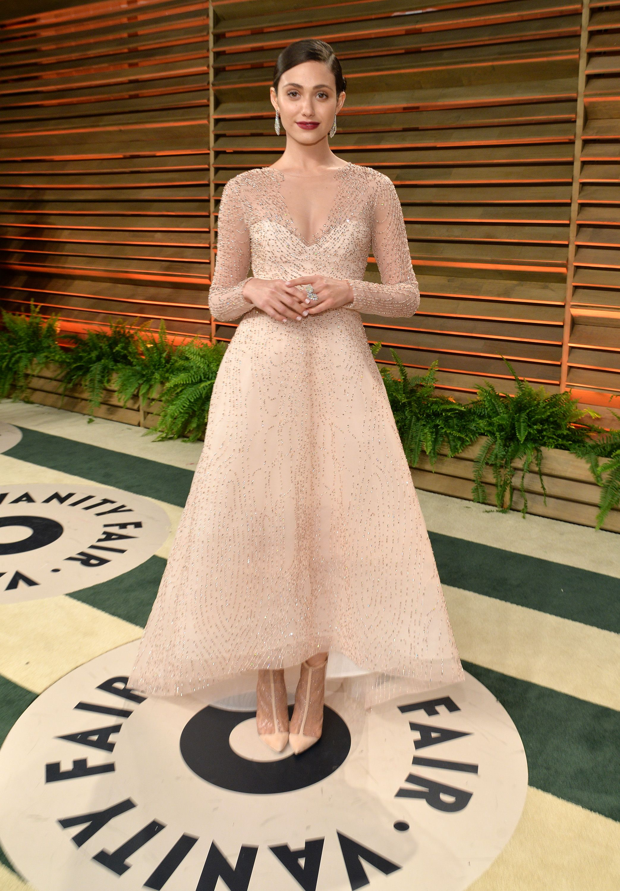 f8f67990176a14 Emmy Rossum  Our favorite thing about Emmy Rossum s Monique Lhuillier dress  at the Vanity Fair Oscar party  The fact that the hemline lets us get a  peek at ...