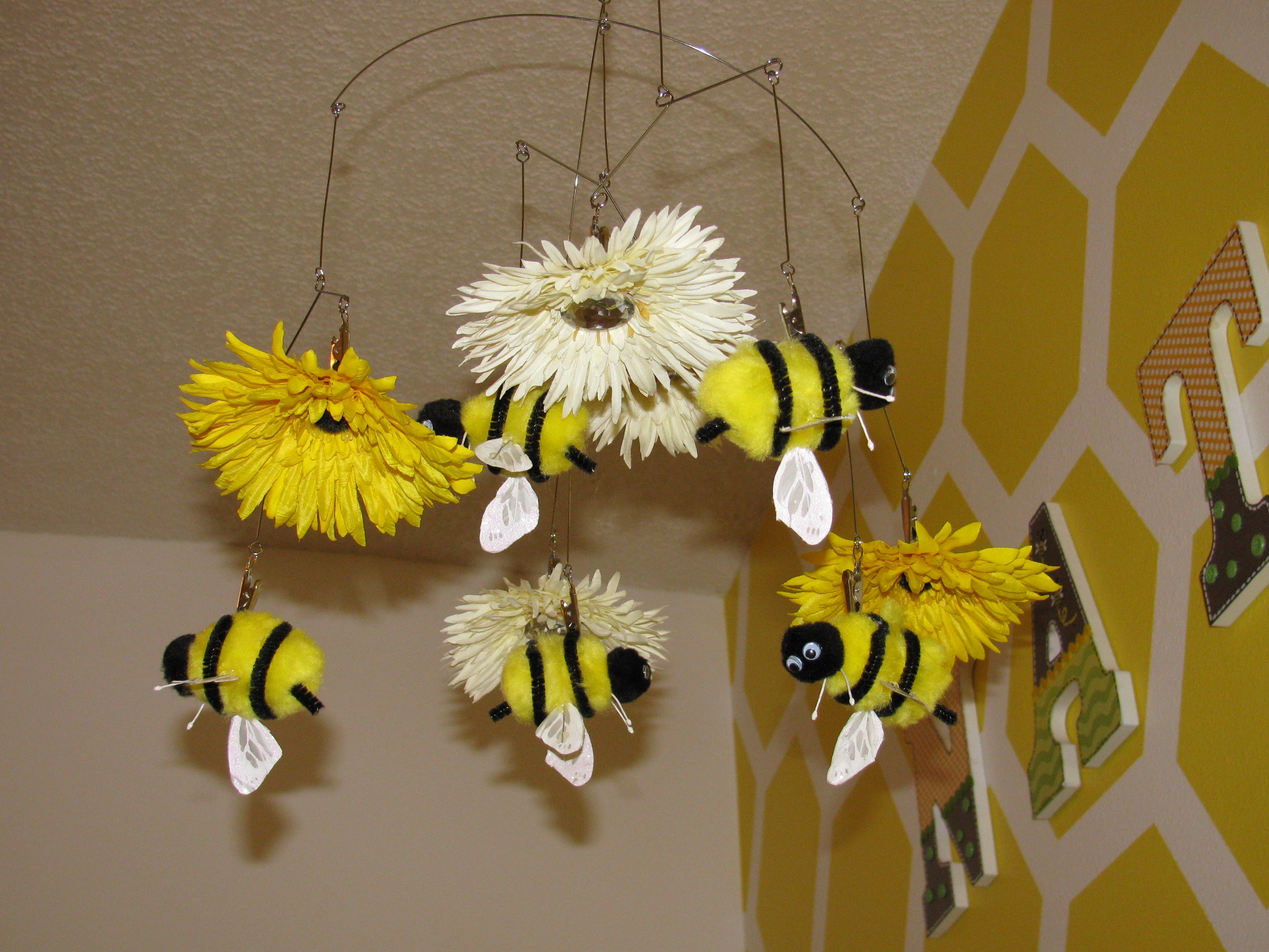 Bumble Bee Nursery - Bee Mobile made using silk flowers, a wire mobile purchased from Amazon, pom pom's, wings from butterflies, anntanes are flower wire stems, pipe cleaner, and google eyes. Spent less than $20 total.