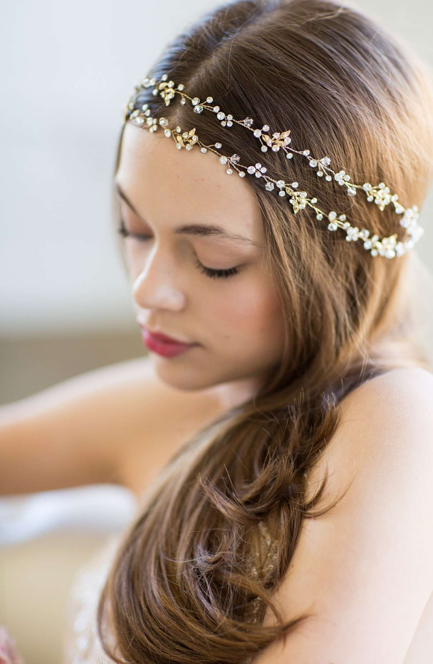hand-wired halo headpiece, gold-plated bands studded with sparkling