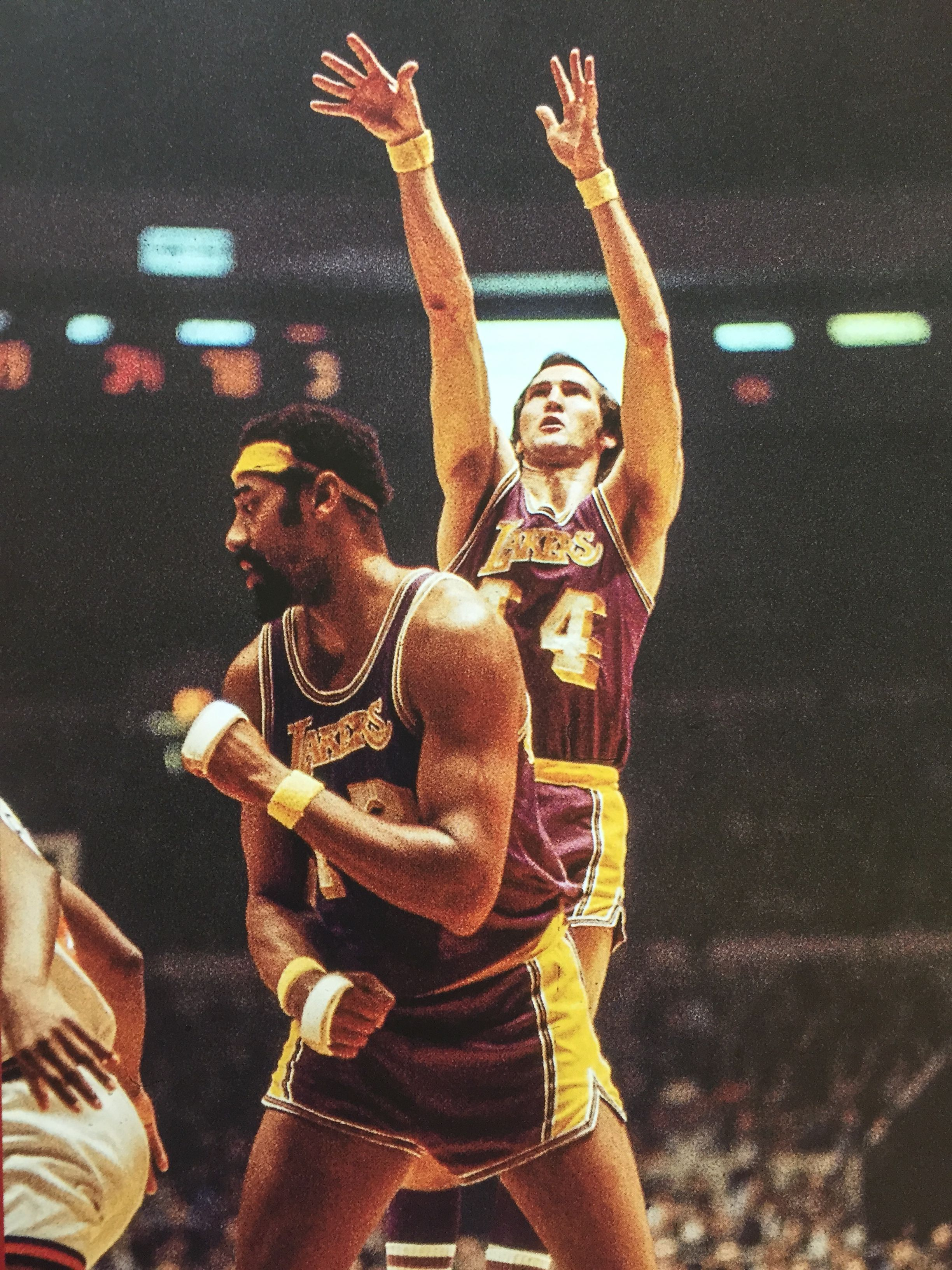 C Wilt Chamberlain sets the screen as G Jerry West shoots