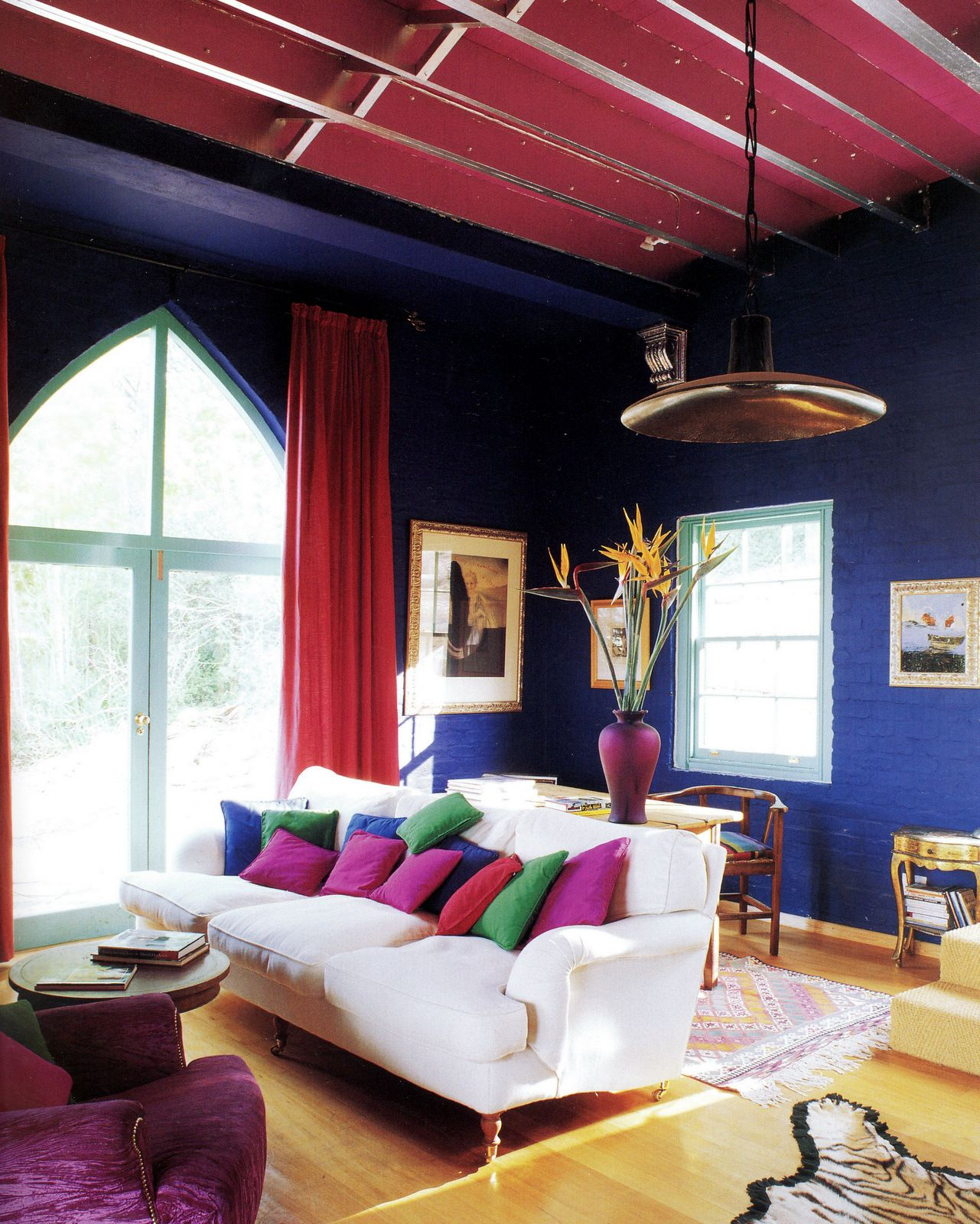 Eclectic Style Living Room With Indigo Walls And A Garnet