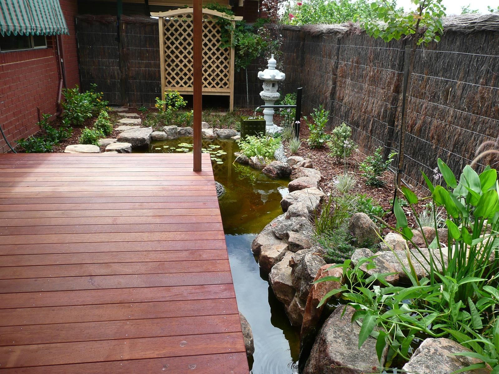 Japanese courtyard garden with koi pond and plant bio for Japanese koi pond garden design