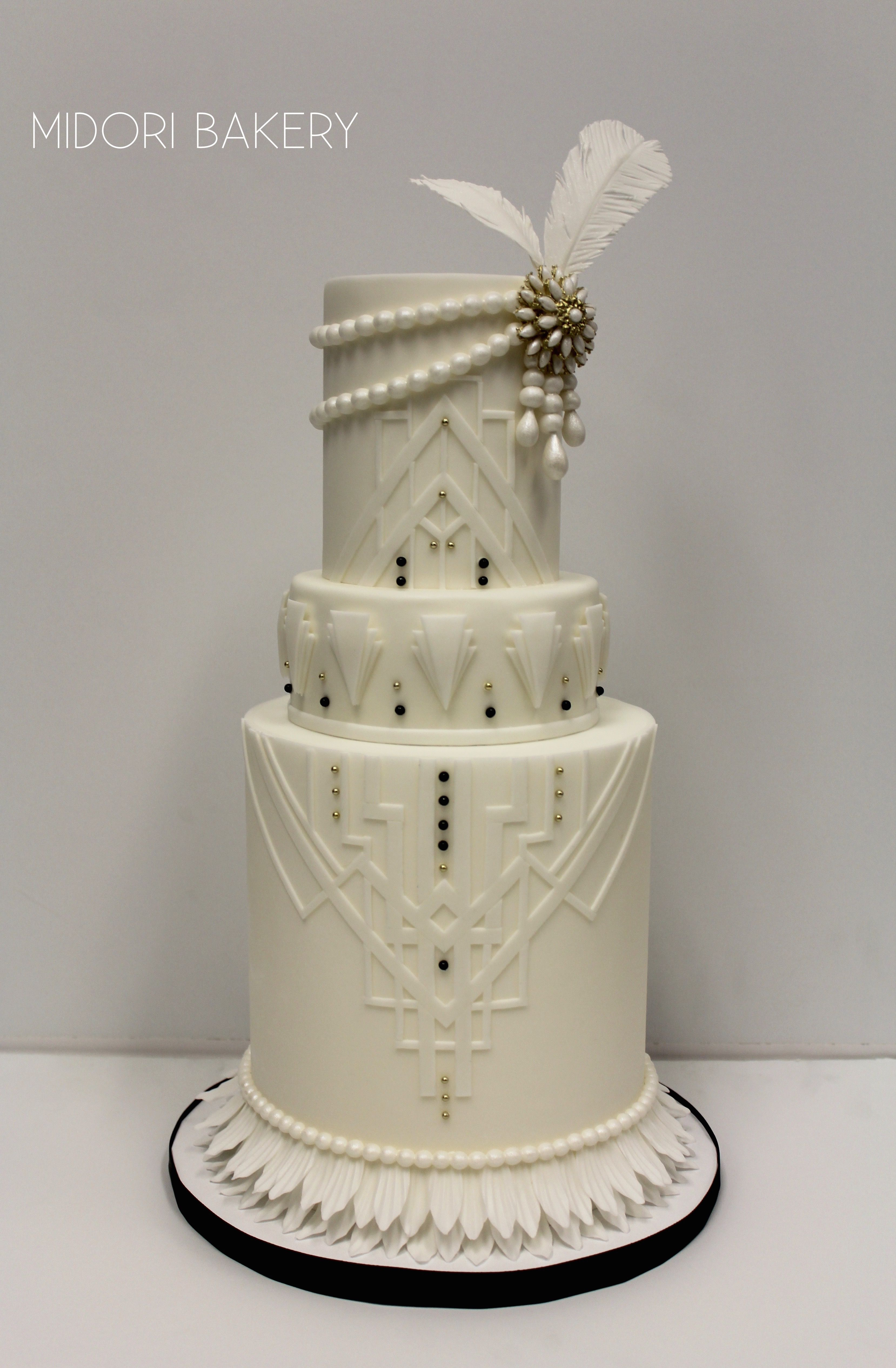 White Art Deco Great Gatsby inspired wedding cake with pearls