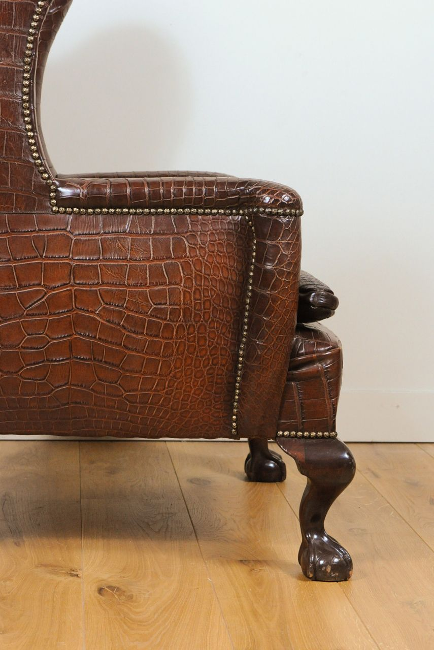 a very unusual and chic crocodile upholstered wing chair