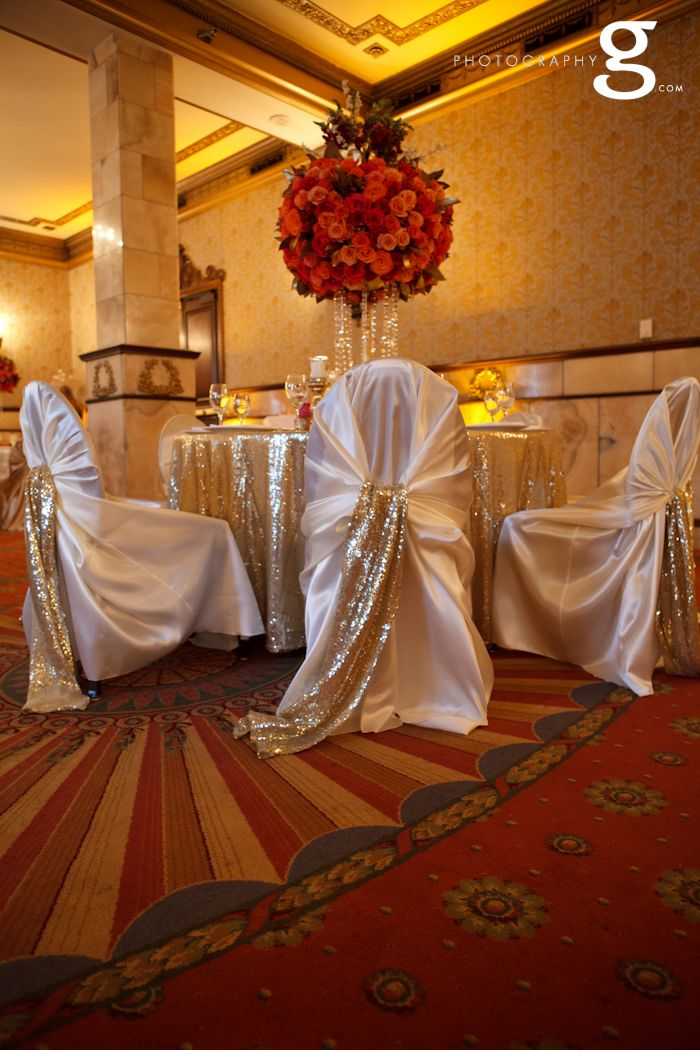 Ivory chair covers, gold sequin chair sash. Soft gold