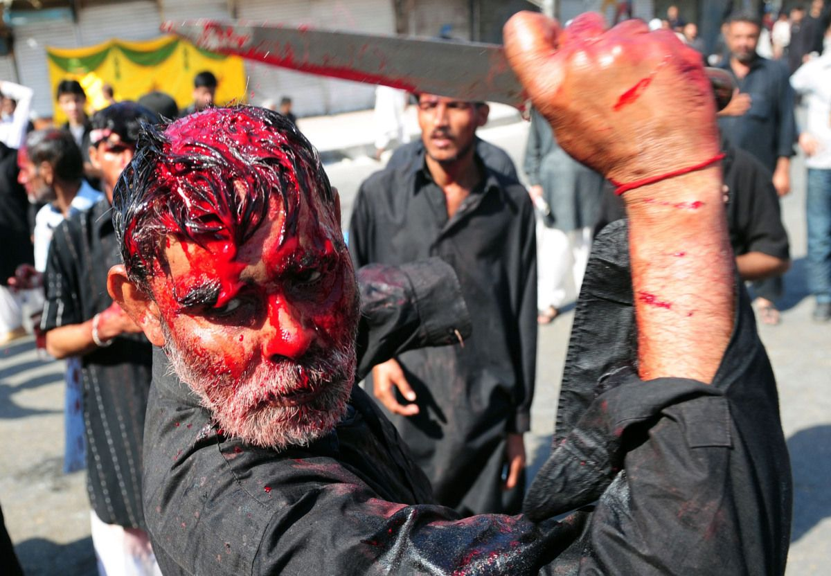 Self-Flagellation  A Pakistani Shiite Muslim mourner performs religious rituals during an Ashura procession in Karachi on December 6, 2011, on the tenth day of the holy month of Moharram, to mark the martyrdom of seventh century saint Imam Hussain. Shiite Muslims stage religious processions on Ashura to commemorate the death of the Prophet Mohammed's grandson