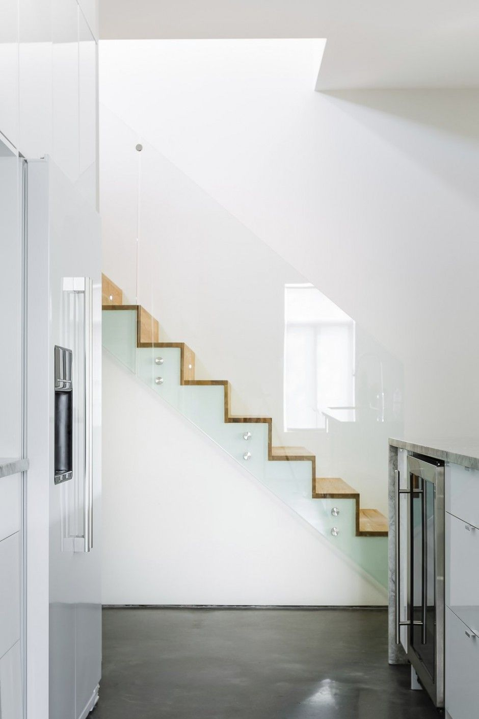 stairs + glass rail + wood plank floor visible from the ...