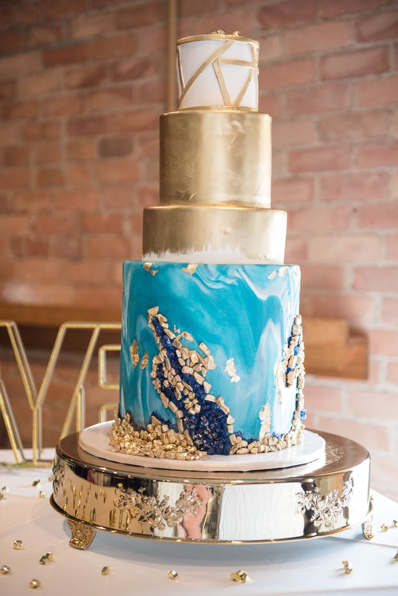 Airbrushed wedding dress  Teal and gold geode wedding cake with blue sugar crystals and
