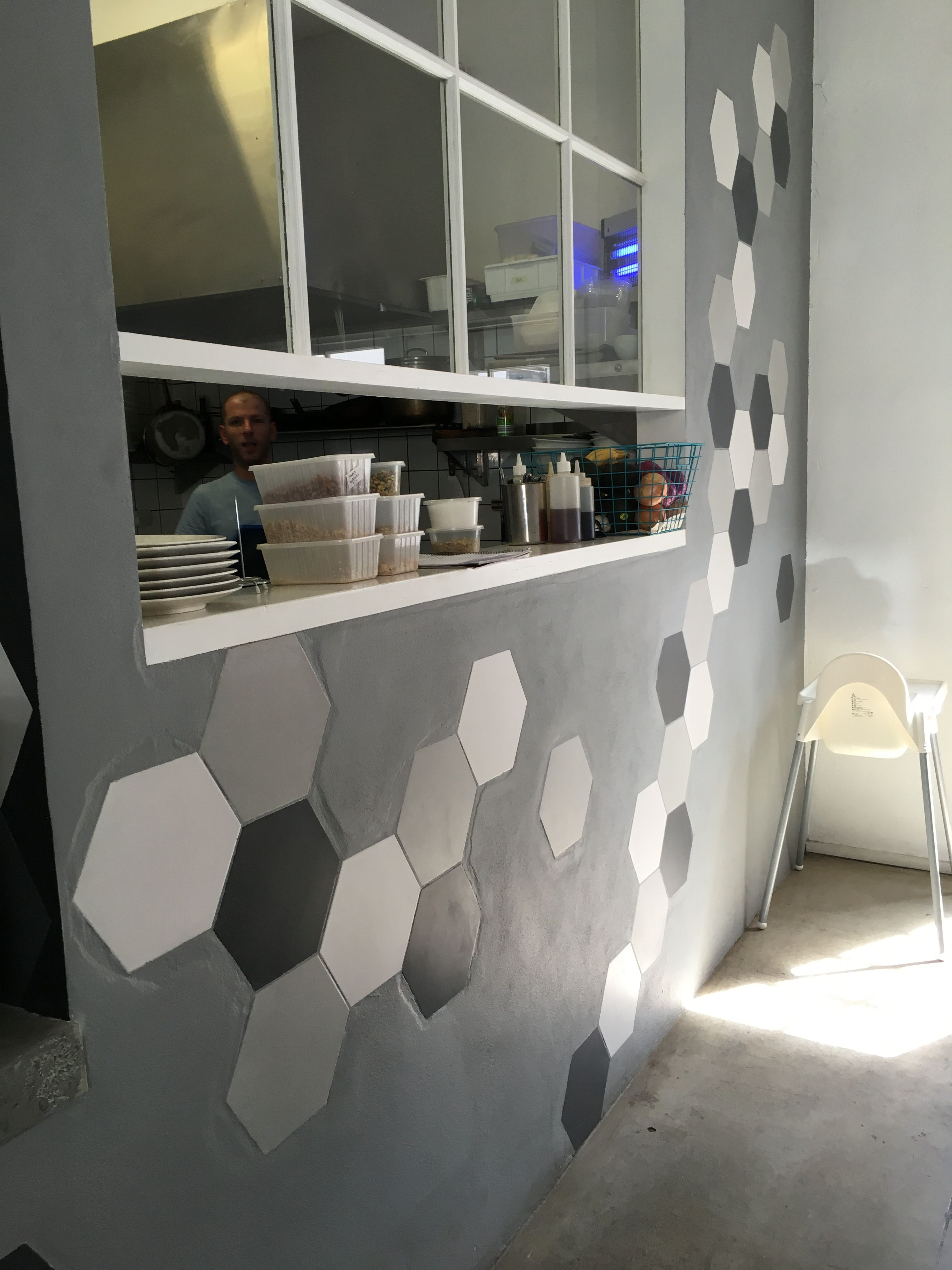 Photo 8 The Feature Wall Of This Cafe Is Made Of Plaster Board Which Has Hexagon Shaped Ceramic Tiles Attached To It And The Feature Wall Design Ceramic Tiles