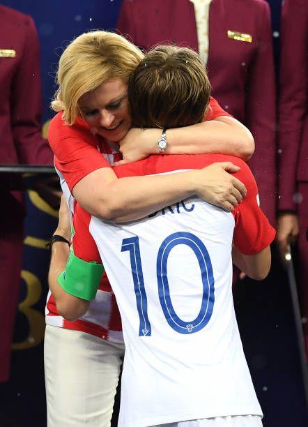 Luka Modric of Croatia embraces Kolinda GrabarKitarovic President of Croatia following the 2018 FIFA World Cup Final between France and Croatia at...