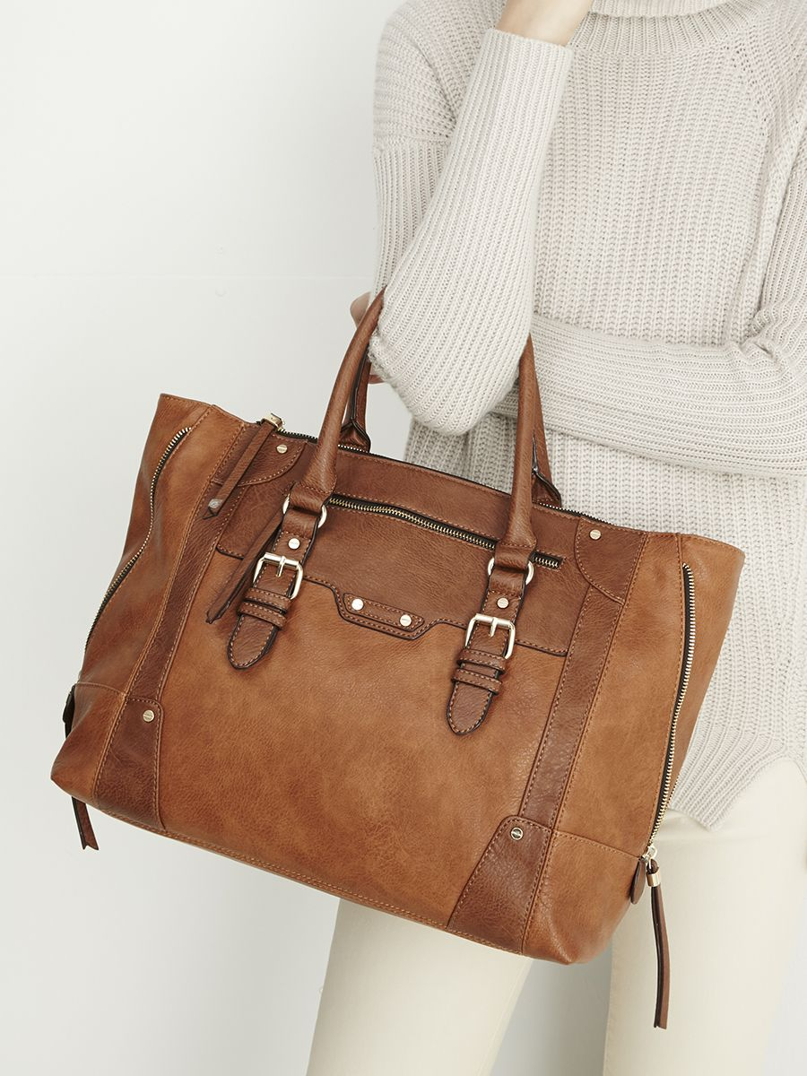 d94985eead6 Spacious winged tote bag in versatile brown you can style with outfits all  year round   Sole Society Susan