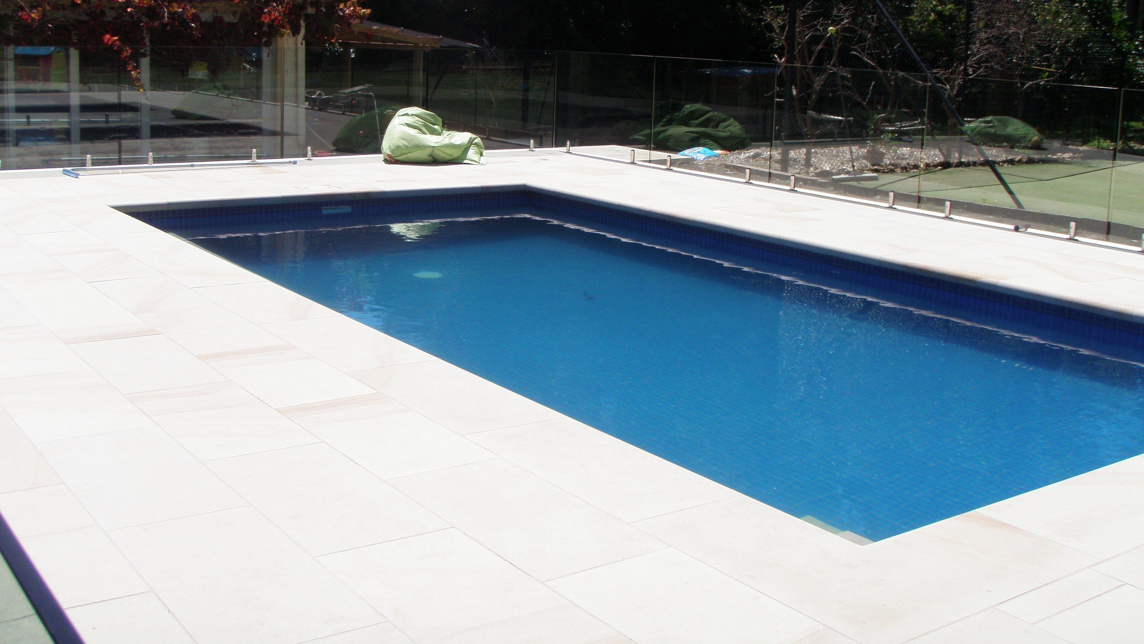 Mt white sandstone pool surround with 75mm bullnosed for Pond surround ideas