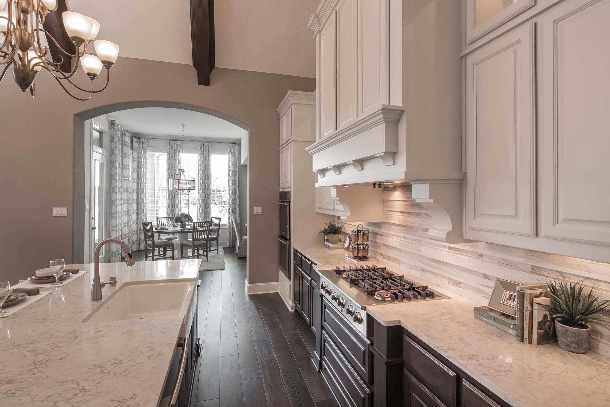 Kitchen in Highland Homes 292 Plan at 6249 Edgestone Drive